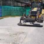 Urejanje parkirišča ob teniških igriščih.